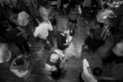 slow-shutter-dancers-blurred-and-wedding-couple-still