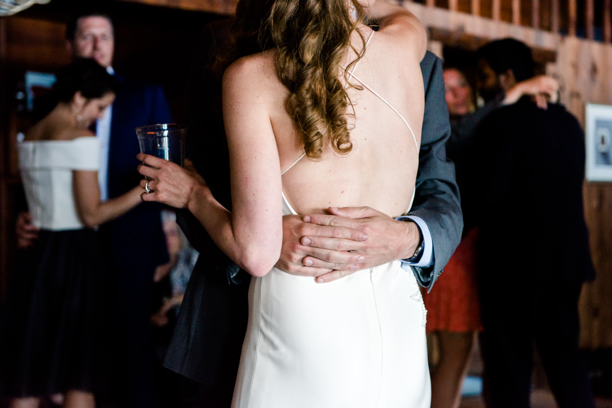 back-of-bride-dancing-with-groom-and-solo-cup