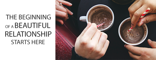 contact-hands-with-coffee-cup