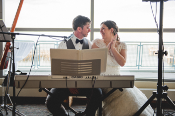 wedding-couple-sitting-at-electric-piano